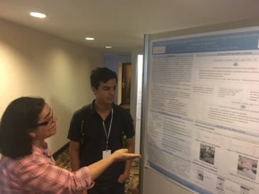 Allan listens to feedback from Prof. Rosaura Romero (Center for Research on Natural Products, UCR)